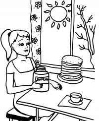 Девочка ест блины с вареньем